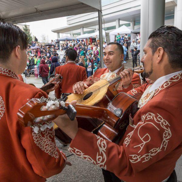 Latino musicians playing guitar