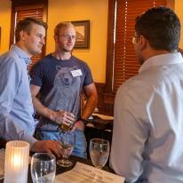 Three men talking in restaurant