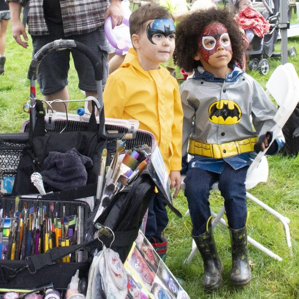 Two boys with face paint at Party in the Park