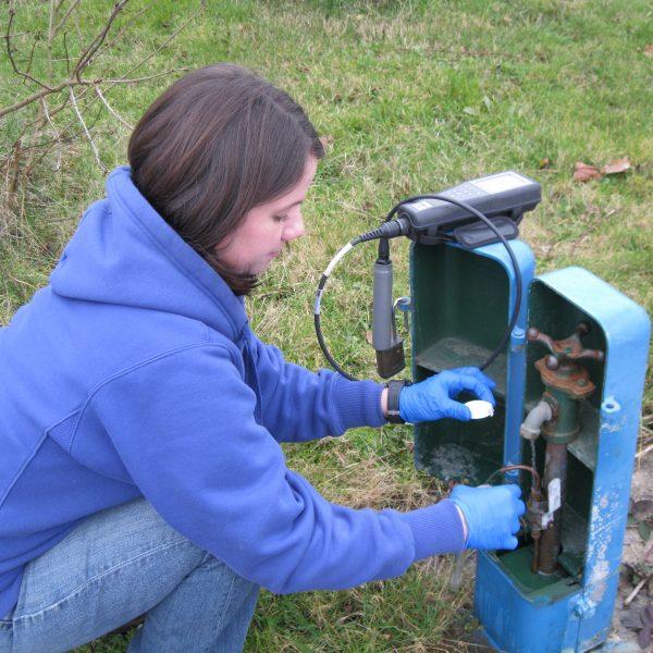 City employee taking water samples